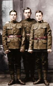 3 child soldiers from WWI pose for a photo in their uniforms